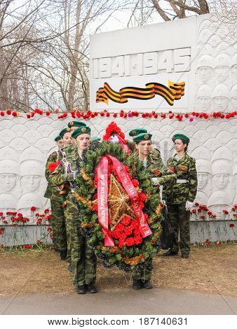 Kirishi, Russia - 9 May, Crowned group at the monument to the defenders, 9 May, 2017. Laying wreaths and flowers in memory of the fallen at the Eternal Flame.