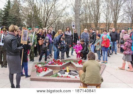 Kirishi, Russia - 9 May, People at the monument of the Eternal Flame, 9 May, 2017. Laying wreaths and flowers in memory of the fallen at the Eternal Flame.