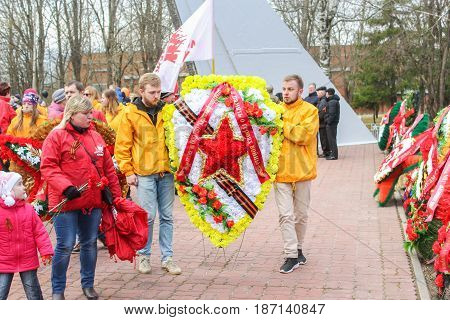 Kirishi, Russia - 9 May, People laying wreaths, 9 May, 2017. Laying wreaths and flowers in memory of the fallen at the Eternal Flame.