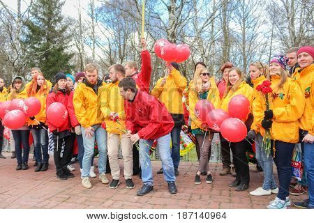 Kirishi, Russia - 9 May, Group of people with balloons, 9 May, 2017. Laying wreaths and flowers in memory of the fallen at the Eternal Flame.