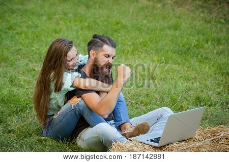 Couple Of Student And Girl Study On Laptop On Grass