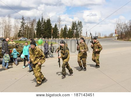 Kirishi, Russia - 9 May, A group of special forces with machine guns, 9 May, 2017. Holiday demonstration speeches of special forces soldiers in honor of Victory Day.