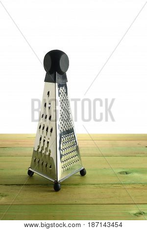 Stainless Steel Grater on a Wooden Background