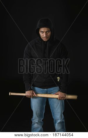 Young African American Robber In Zoodie With Baseball Bat Isolated On Black