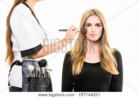 Makeup Artist Applying Blusher To A Young Woman