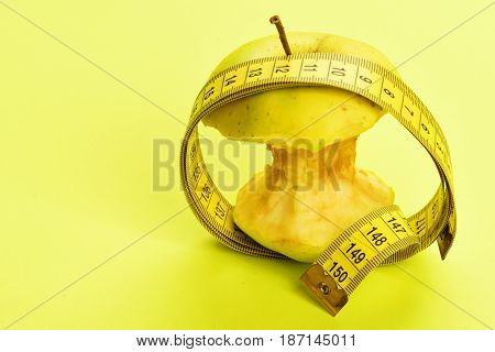 Circle Of Measuring Tape And Bitten Apple In It