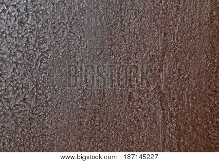 Abstract brown texture. Wood surface covered with paint with craquelure effect. Rough background with place for text.