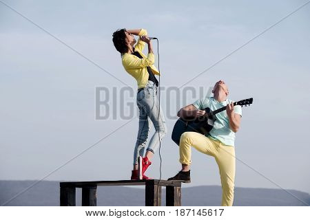 Singer Singing On Table And Handsome Man Playing Guitar