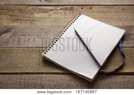 Blank Note Book on a Wooden Background
