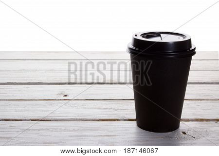 Coffee in Takeaway Cup on Wooden Background