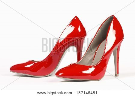 Lacquered shiny red shoes high heels on white background.