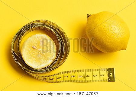 Calorie And Fitness Concept. Lemon Slice With Measuring Tape, Yellow