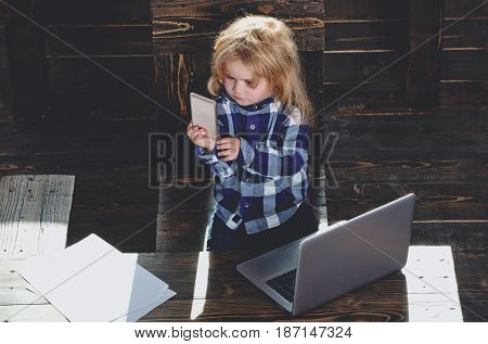 Small Cute Business Boy With Phone And Computer In Office
