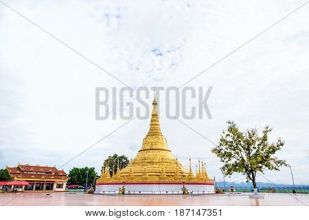 Tachileik Shwedagon Pagoda is a beautiful golden pagoda that imitates Shwedagon Paya Pagoda tourist attraction near the Thai border at Tachileik town in Shan State Myanmar