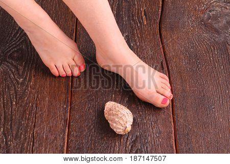 Closeup photo of a beautiful female feet with pedicure.