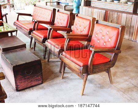 Set of vintage old wooden chairs with red cushion