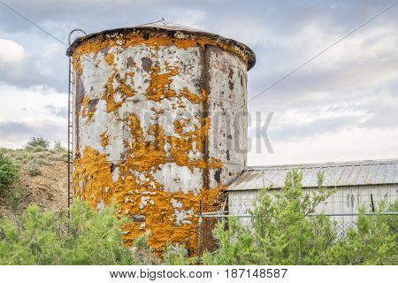 old water tank covered by lichen near Thompson Springs at Book Cliffs in eastern Utah