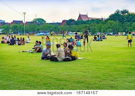 Bangkok, Thailand - December 4, 2015: Unidentified people come to Sanam Luang for relax and picnic on the grass. It is the open field in the front of Grand Palace in Bangkok, Thailand.