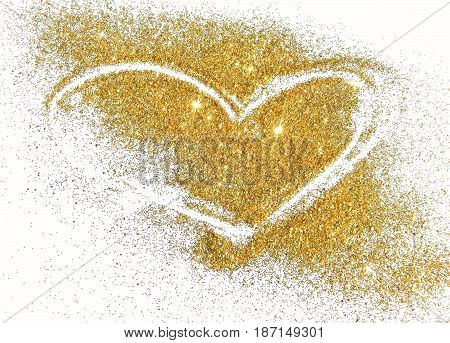Abstract heart of golden glitter sparkles on white background.