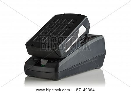 battery and charger for cordless tools on white background