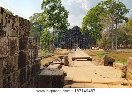 Siem Reap, Cambodia - February 2, 2016: Tourists visit to Baphuon Temple in Angkor Complex, Siem Reap, Cambodia. Famous Cambodian landmark, World Heritage is dedicated to the Hindu God Shiva.