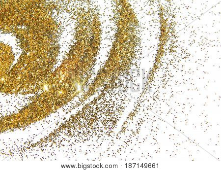 Abstract spiral of golden glitter on white background.