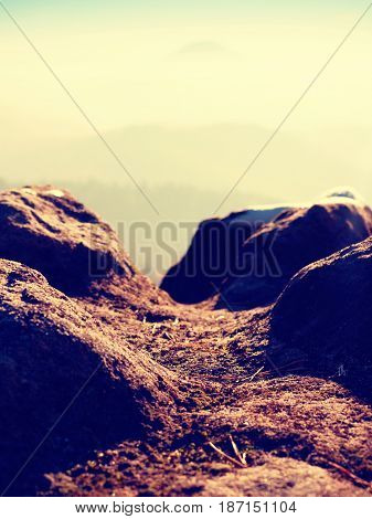 Rocky Peak Above Inverse Mist. Winter Cold Weather In Mountains, Colorful Fog. Misty Valley
