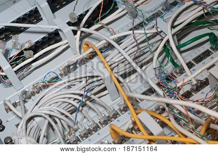 Network LAN cables close-up in the mounted server cabinet. Sloppy wiring