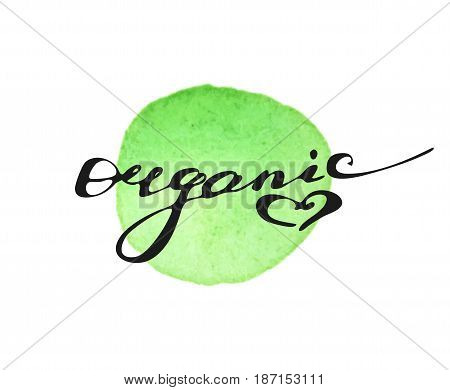 Hand written word Organic on green watercolor splash on white background