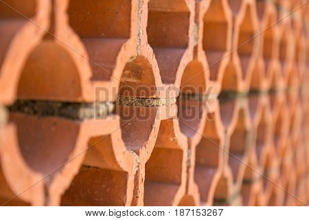 Terracotta honeycomb exterior wall. Abstract background with shallow depth of field and space for text.