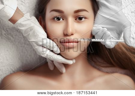 Portrait of woman getting cosmetic injection. Clean Beauty. Looking at camera