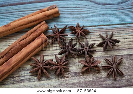 Cinnamon sticks and star anise on vintage wooden background