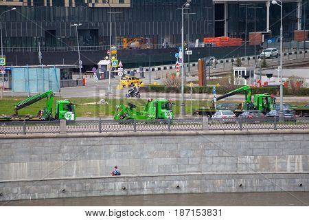 MOSCOW, RUSSIA - MAY 01, 2017: Urban car tow trucks on the embankment of the Moscow River
