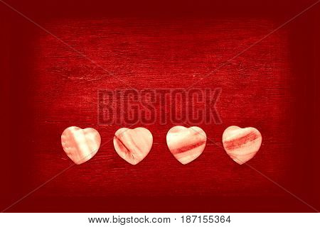 Bright red background with decorative hearts. Free space