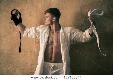 Karate Man Or Master With White And Black Belts