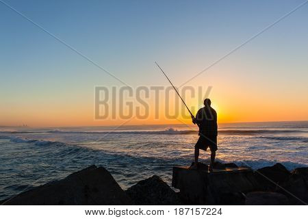 Fisherman Silhouetted  Ocean Beach Sunrise