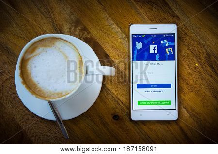 Udon Thani Thailand - May 102017 - The coffee shop and relax time using log in facebook social media on smart phone