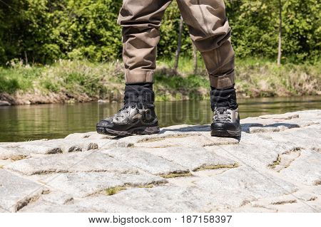 Fishing boots for wading in the river. Special fishing boots for fly fishing. Detail on shoes.