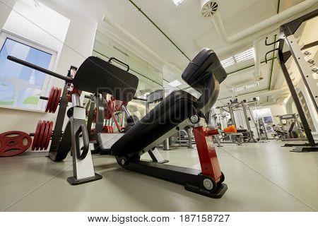 Diagonal leg press training machine in gym room.