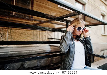 Stylish Blonde Woman Wear At Jeans, Suglasses, Choker And Leather Jacket At Street. Fashion Urban Mo
