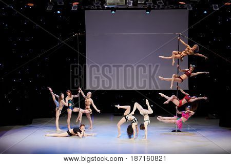 MOSCOW, RUSSIA - FEB 11, 2017: Group of female participants of Pole Dance Show on stage in Korolevskiy concert hall. Concert hall is designed for 750 spectators.