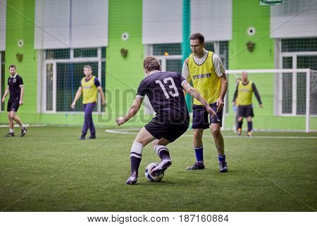 MOSCOW, RUSSIA - JAN 23, 2017: Episode in futsal game between teams at indoor field.
