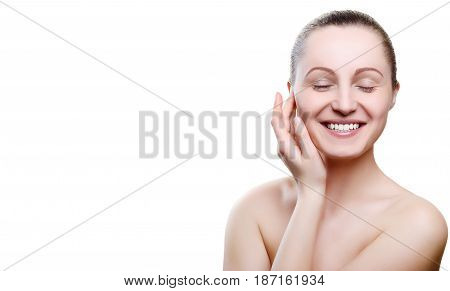 Portrait Of A Smiling Girl With Nude Make-up With Hands On Chin Isolated On White Background. Girl W
