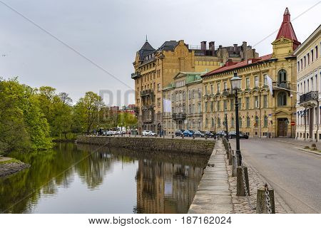 A typical city scene from the main canal that runs through Gothenburg in Sweden.