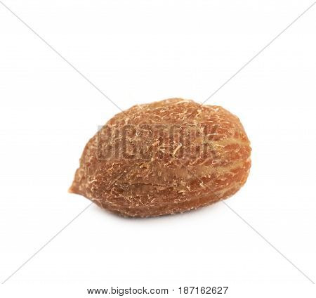 Single green olive pit isolated over the white background