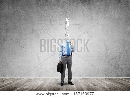 Faceless businessman with exclamation sign instead of head