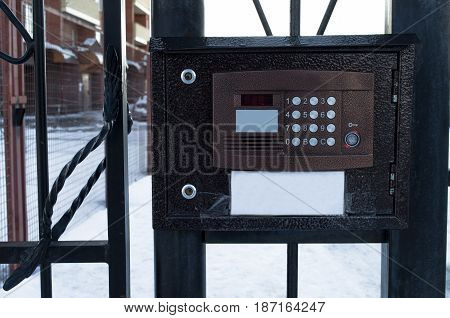 Intercom in the yard of living house. Security and privacy concept.