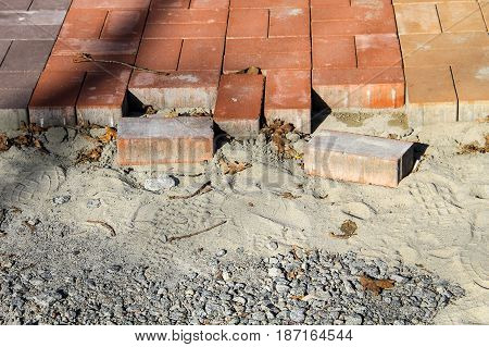 Construction of a new pavement of paving slabs. Pavement cobblestone blocks construction of path road or sidewalk