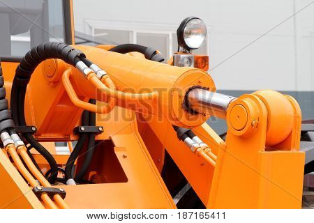 Hydraulic hoses and piston of a modern tractor.