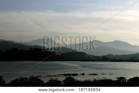 Mountains in the distance with a lake in front.